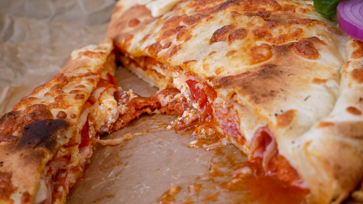 Pizza Parma AdobeStock_306792943 What's the Difference Between a Calzone and Stromboli? Uncategorized  stromboli pizza Italian food calzone